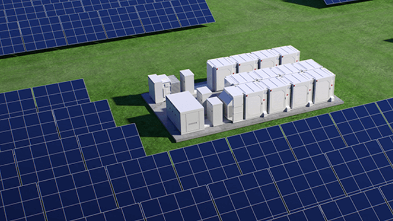 tech - aerial view of solar panels and control boxes