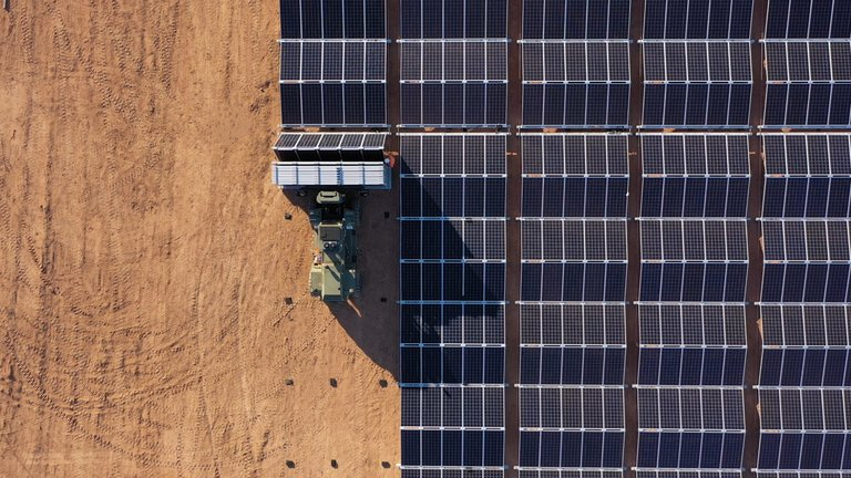 tech - overhead view of tractor moving solar panels into place port bonython