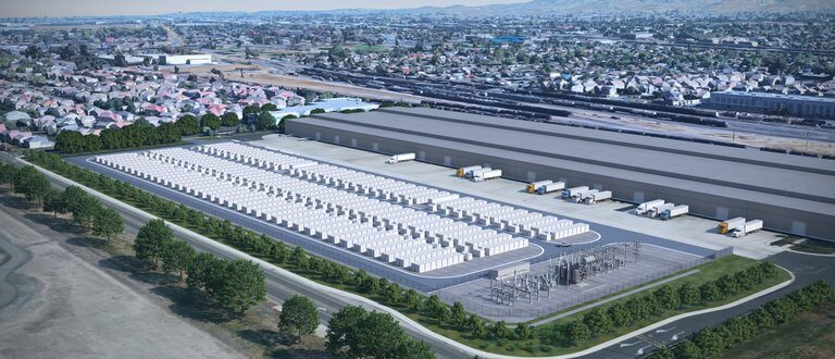 A vast battery storage array from the air in the middle of a metropolitan area.
