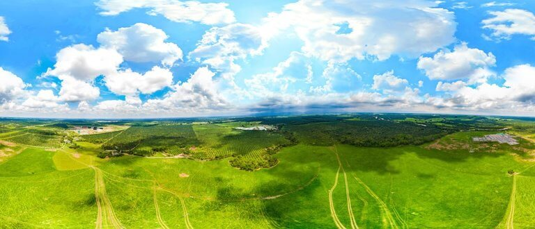 geo - aerial view of colombia fields forest and sky