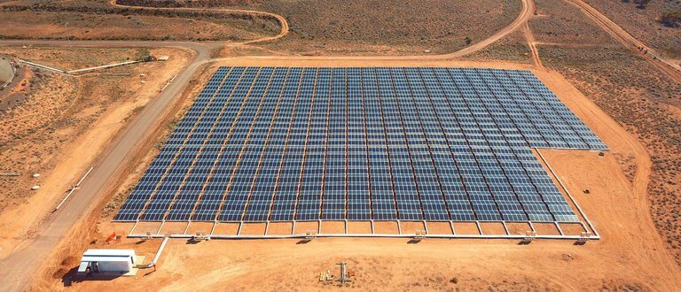tech - aerial view of solar panels and desert panama